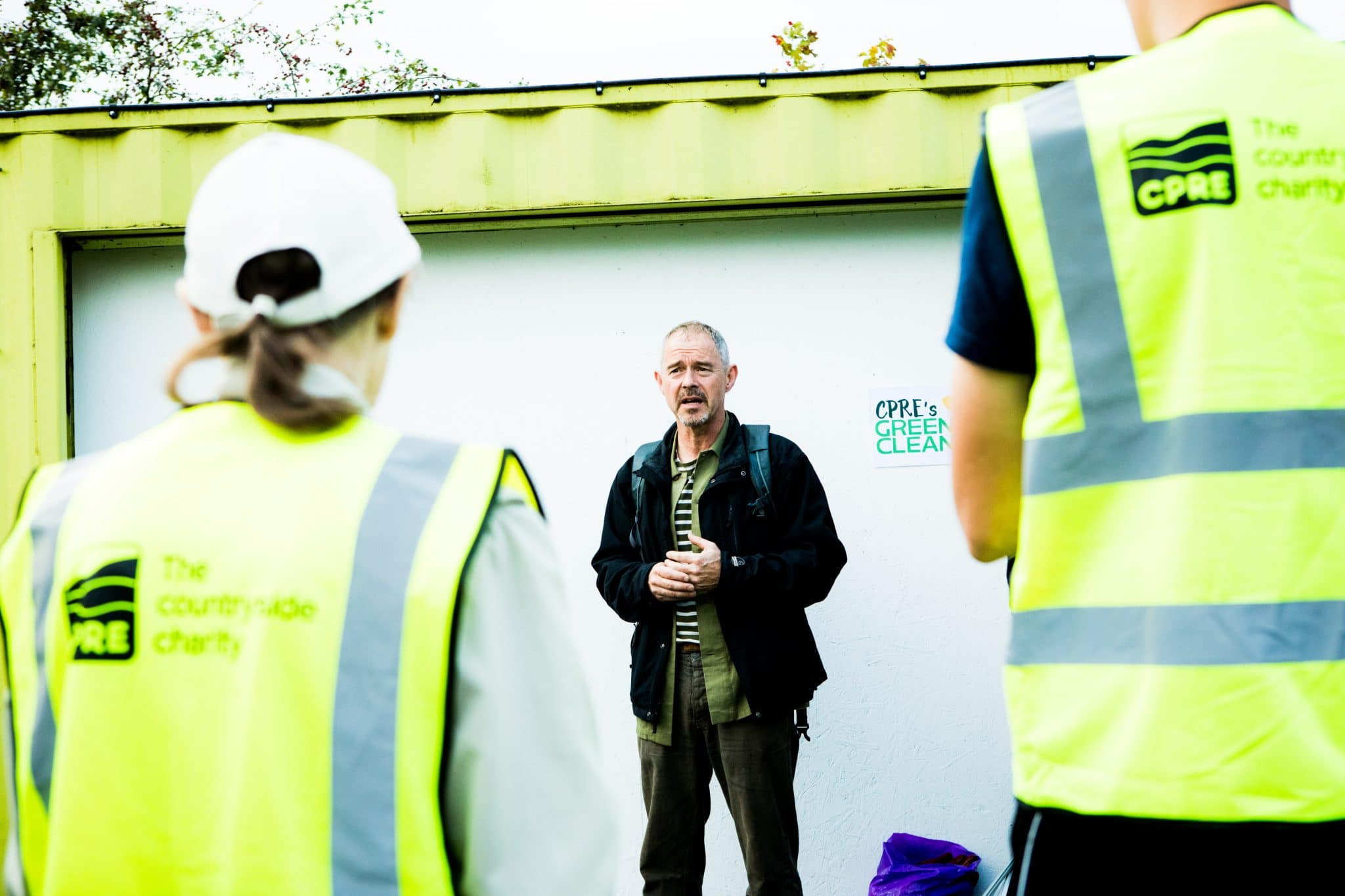 Man speaking to volunteers before litter pick