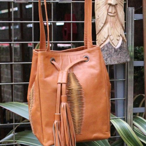 Brown leather bag with cut and tassel detail