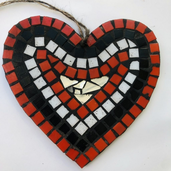 Small heart shaped mosaic with black, red, white, and gold colours