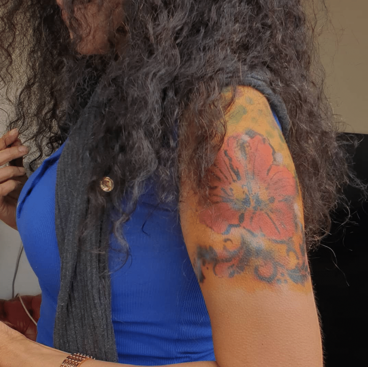 Flower tattoo on a woman's arm